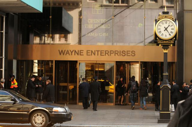 """The entrance to Trump Tower, renamed Wayne Enterprises, is shown on Fifth Avenue, Friday, Oct. 28, 2011 in New York. The building was renamed Wayne Enterprises during the filming of the latest Batman film, """"The Dark Knight Rises."""" (AP Photo/Darla Khazei)"""