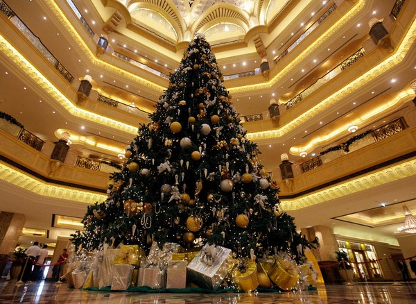 A Christmas tree which has been decked out with $11 million (euro8.3 million) worth of gold and precious stones, stands at the lobby of the Emirates Palace hotel, in Abu Dhabi, United Arab Emirates, on Thursday, Dec. 16, 2010. The hotel's general manager, Hans Olbertz, was quoted in local newspapers Thursday as saying the 43-foot (13-meter) faux fir has 131 ornaments that include gold and precious stones including diamonds and sapphires. The $11 million symbol of the season has become the latest extravagance at the Emirates Palace hotel, which boasts its own marina, heliport and a vending machine that pops out small gold bars. (AP Photo/Hussein Malla)